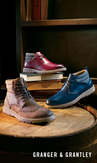 Men's Boots category. The featured products are the Granger Wingtip Lace Boot in Brown Crazy Horse and the Grantley Plain Toe Chukka Boot in Indigo and Cranberry.